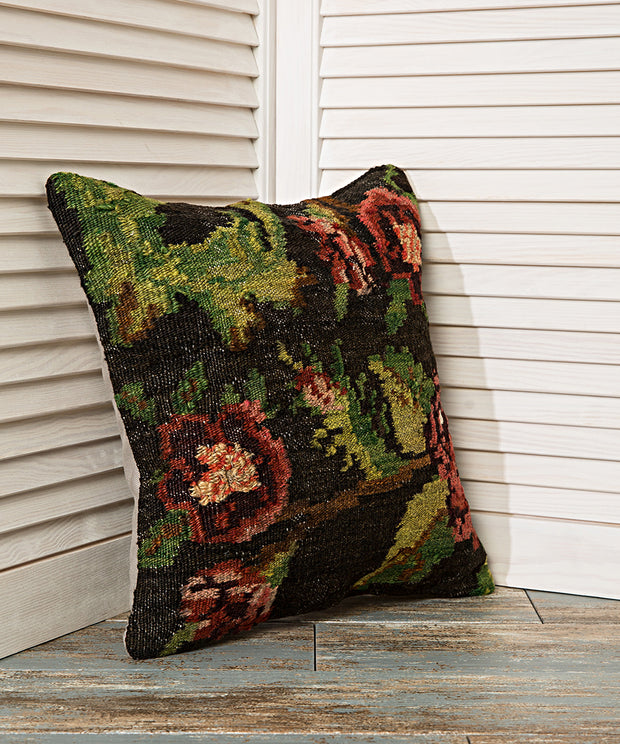 black floral accent pillow