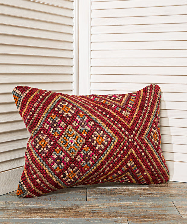 red versatile couch pillow