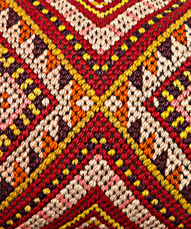 yellow and red geometric pillow