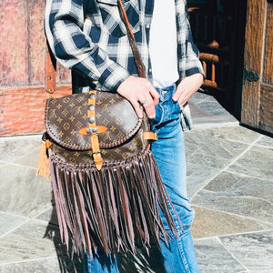 Buckled Buffalo Fringe Purse