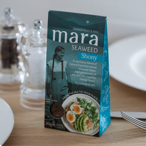 Mara Seaweed Shony pouch on the kitchen table at dinner