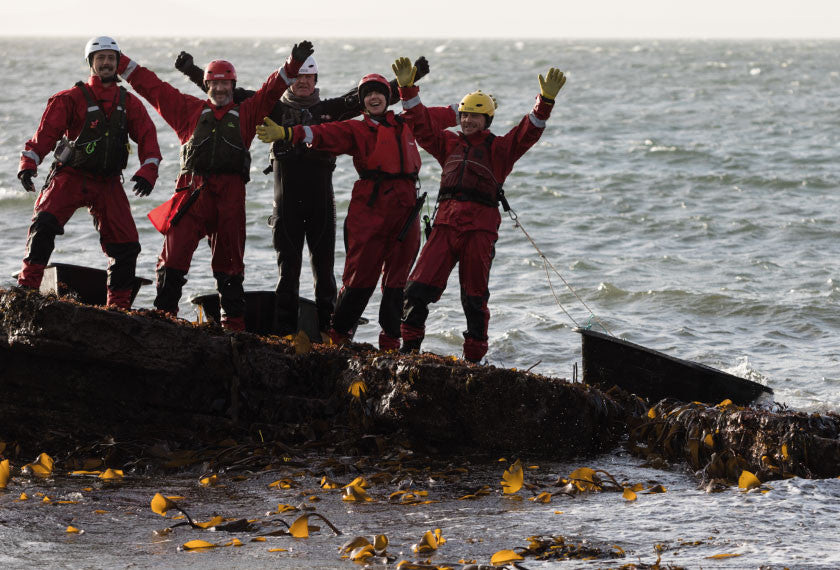 Mara Seaweed harvesters celebrating on the rocks