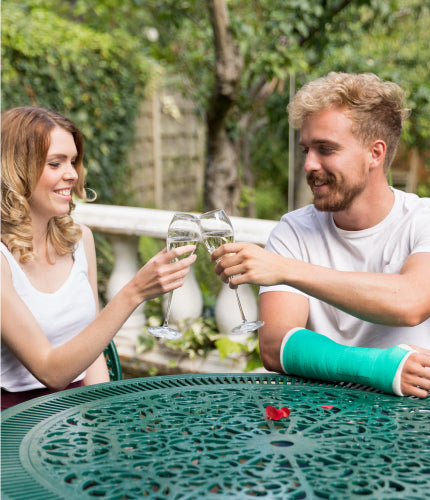 benecare medical, young couple enjoying the sun, man has a broken arm in casting tape