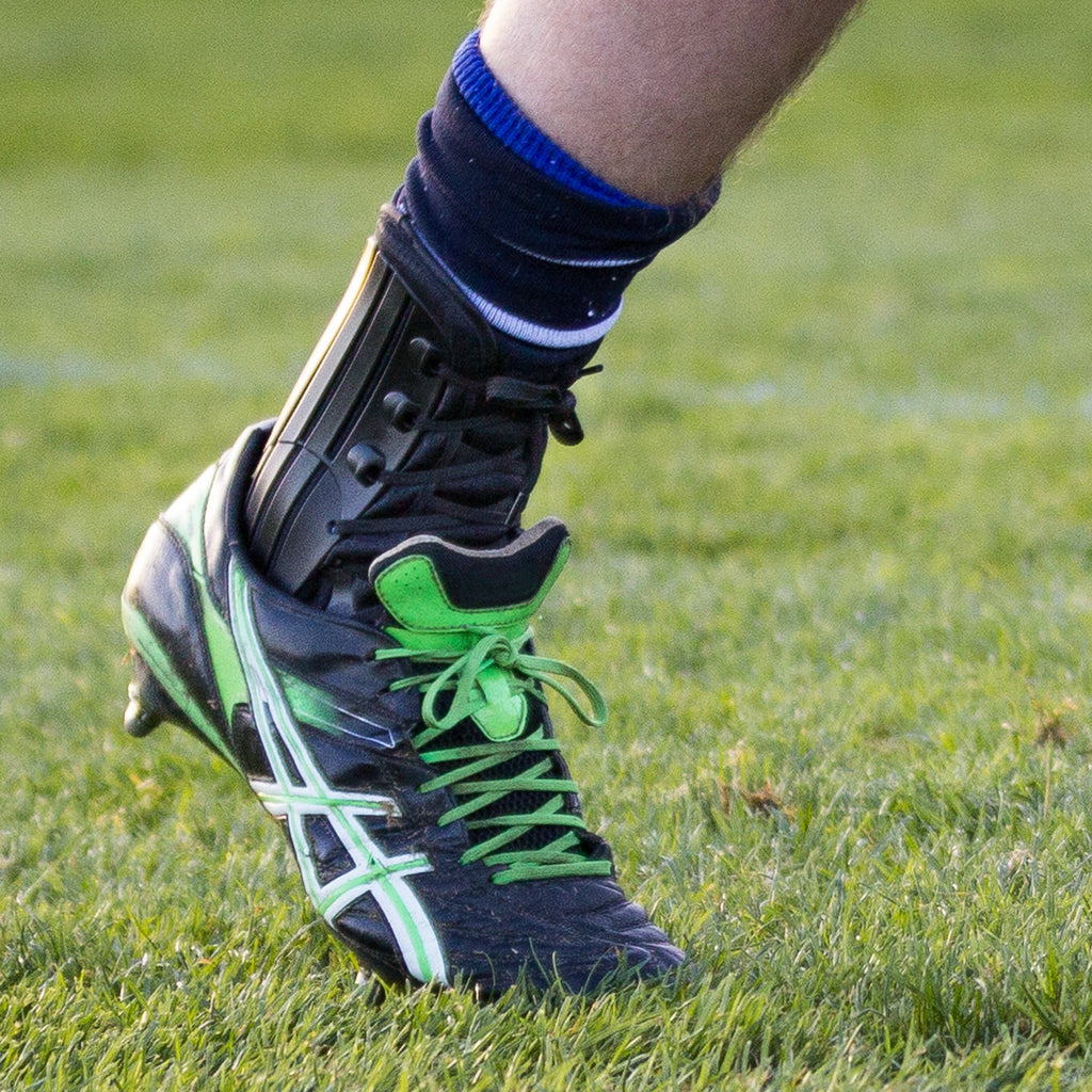 George Nott of Sale Sharks Rugby Club wearing the Benecare EXO Ankle Brace.