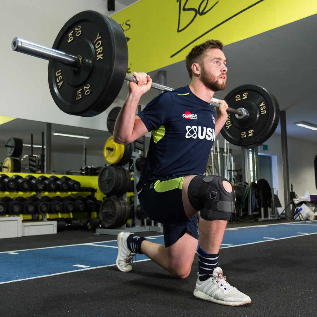 George Nott of Sale Sharks Rugby Club doing a lunge wearing the Benecare Hinged Knee Stabiliser.