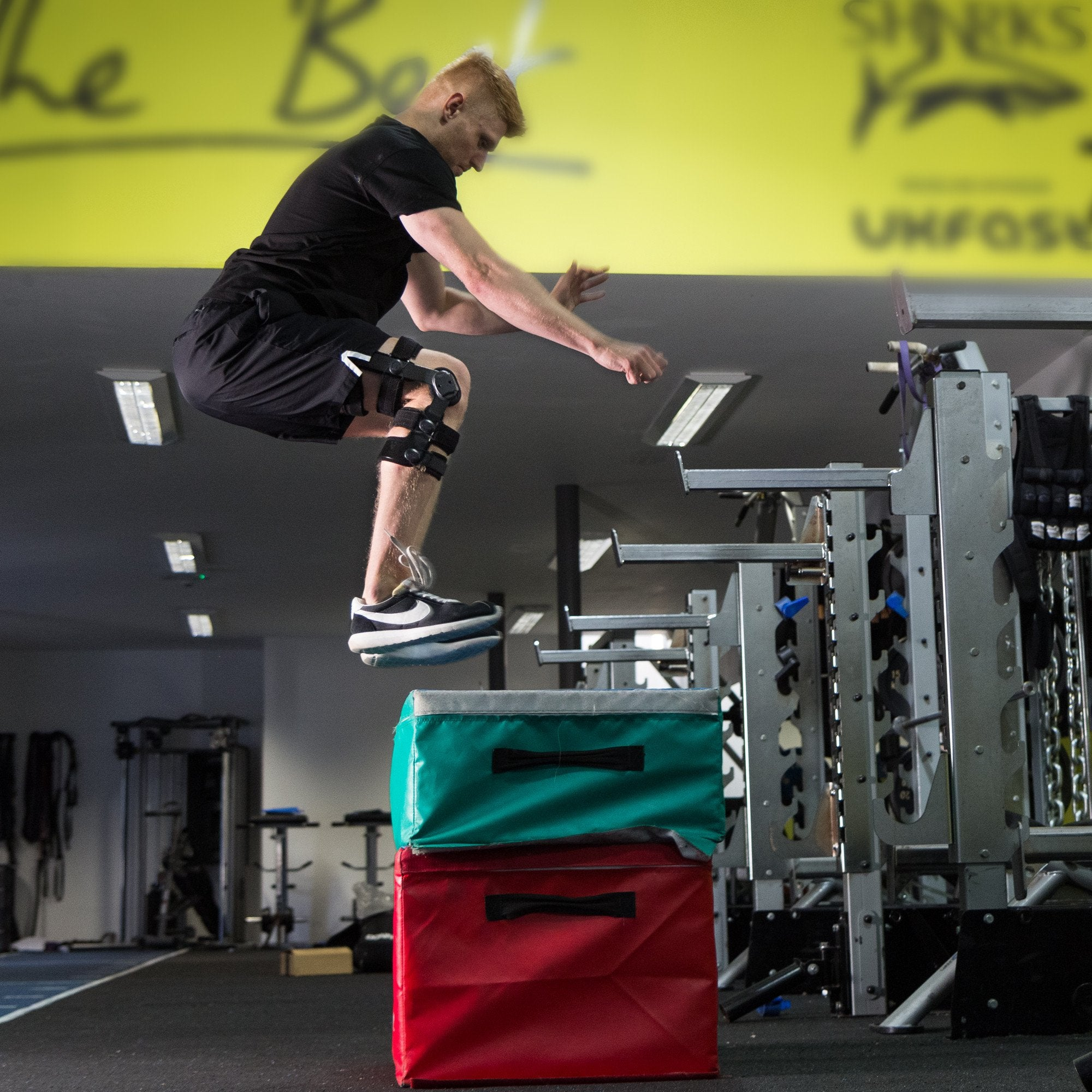 Athlete doing box jump wearing the Benecare Pro Action Knee Brace.
