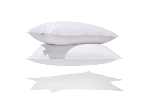 stack of 2 down perfect pillows with green label