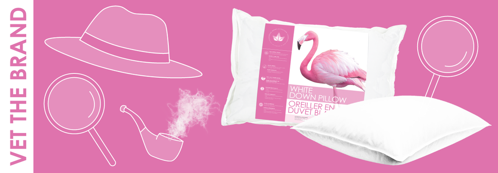 detective hat, magnifying glass and pipe with pillows on pink background