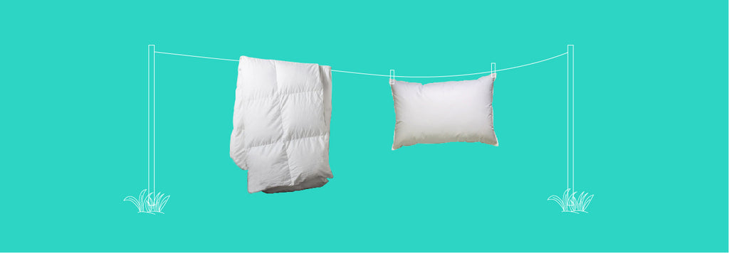 duvet and pillow hanging on clothesline