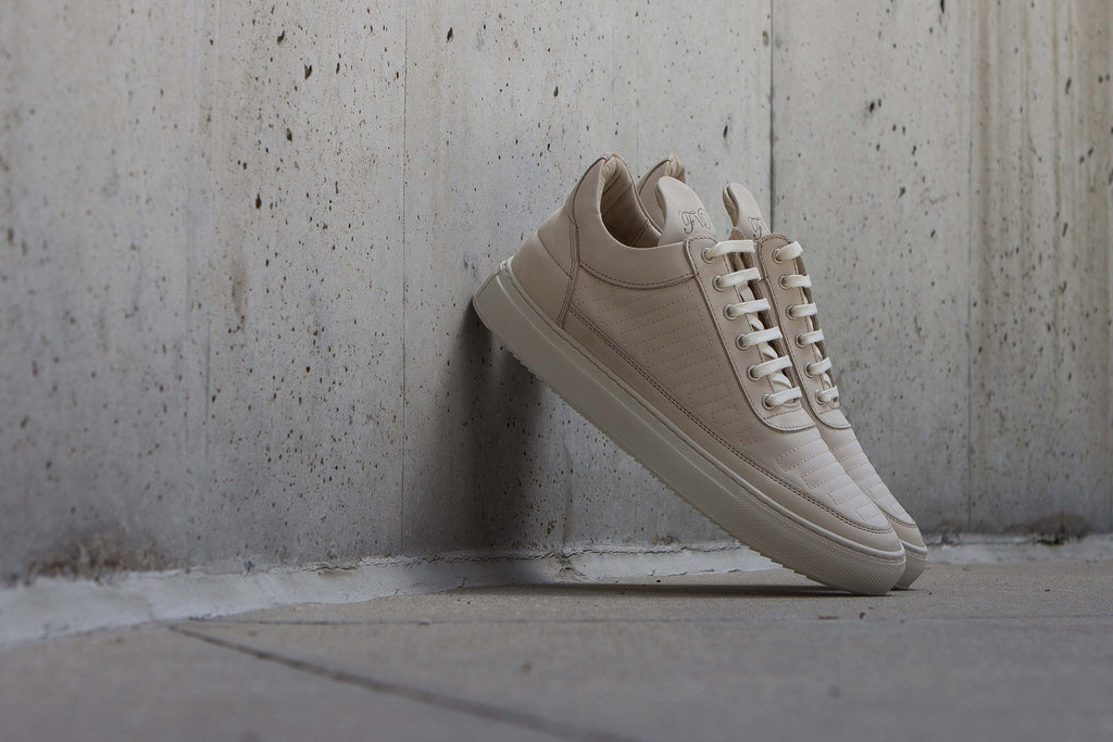 Filling Pieces Low Top in Marathon Beige Against Wall