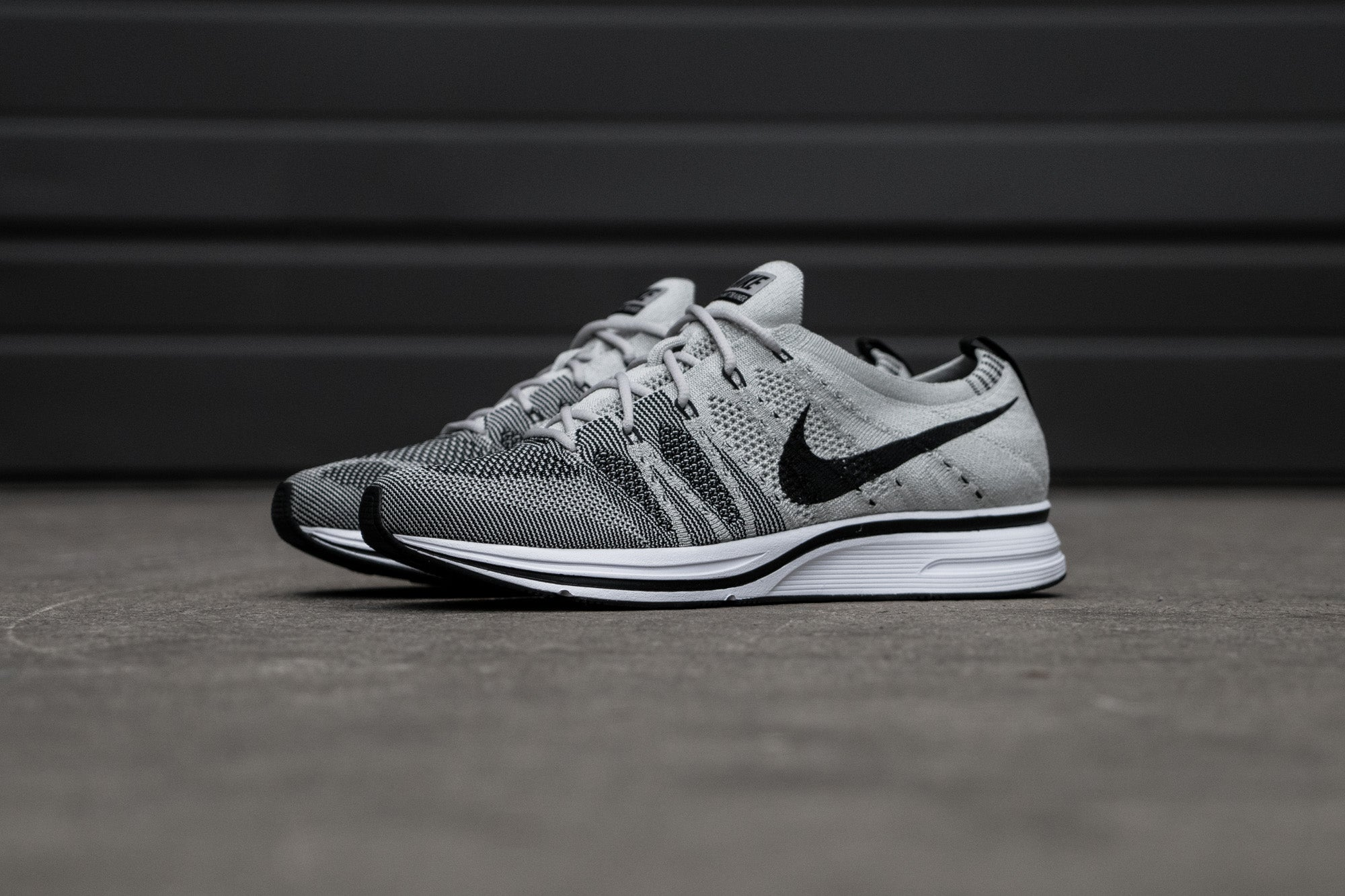 2926017a410ce5 ... Nike Flyknit Trainer - Pale Grey   Sunset Tint at Notre ...