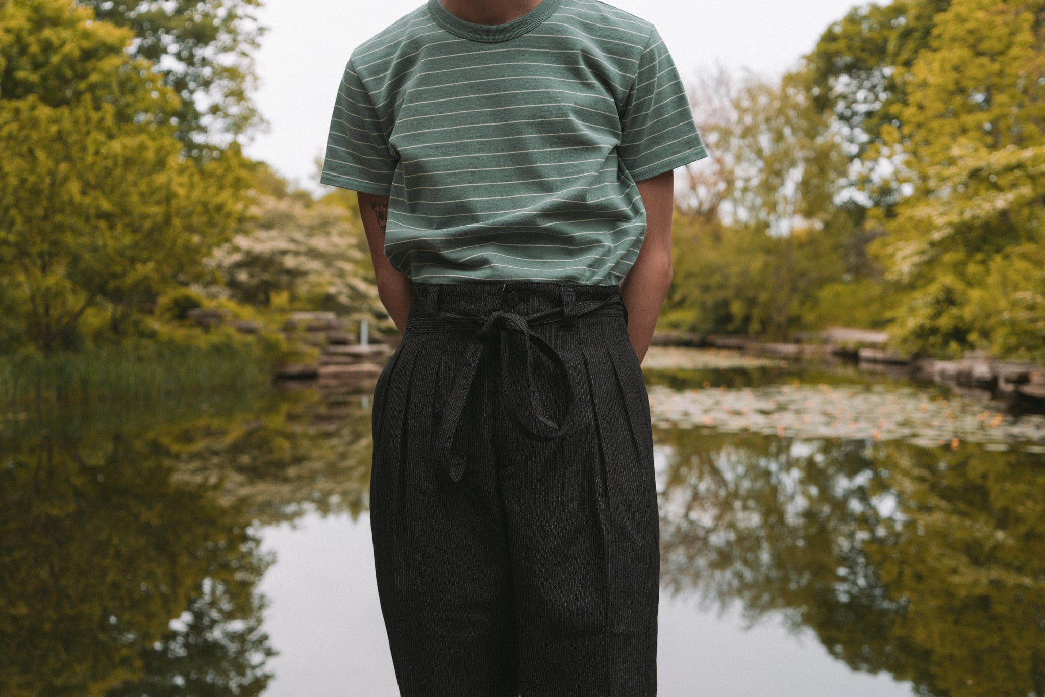 Visvim SS'17 at Notre - Hakama Pants in Pinstripe Black & Mid Border Tee S/S in Green