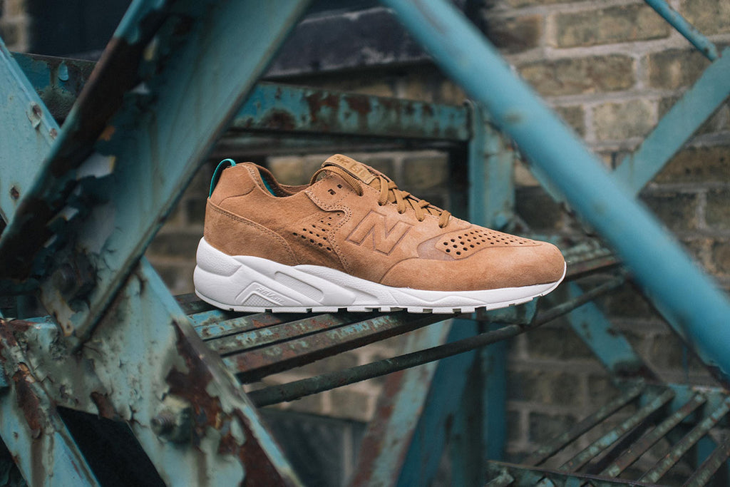 New Balance Deconstructed 580 in Tan Outside Fire Escape Shot