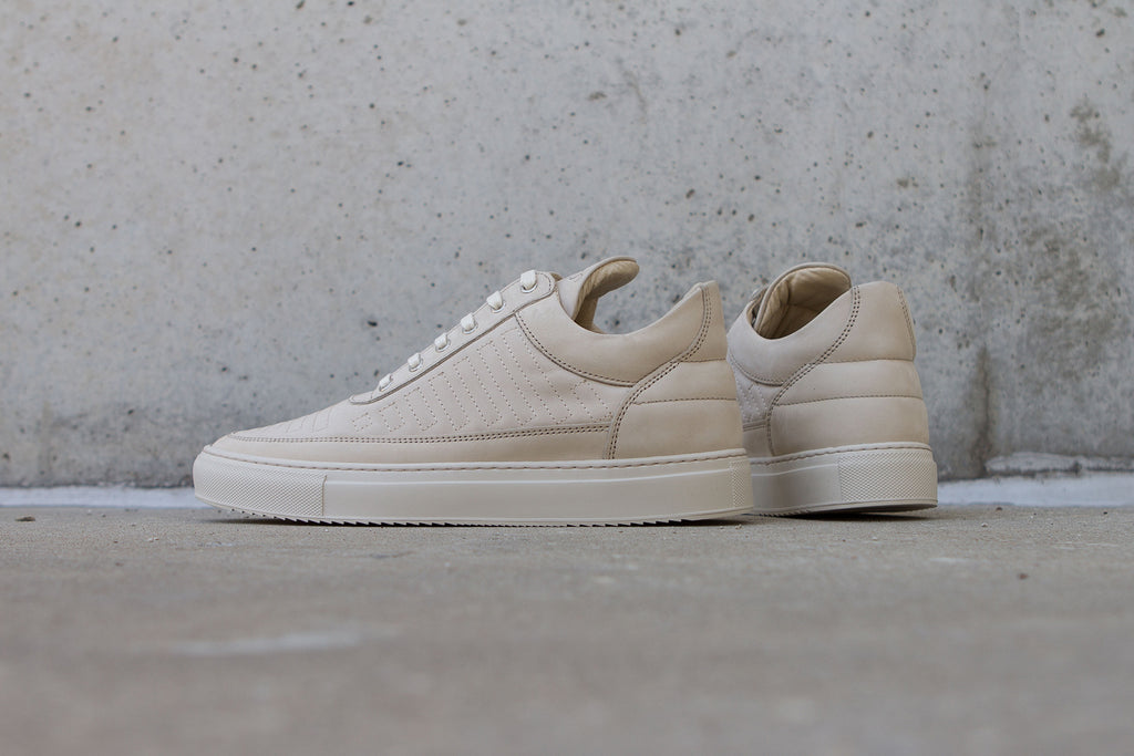 Filling Pieces Low Top In Marathon Beige on Concrete Floor