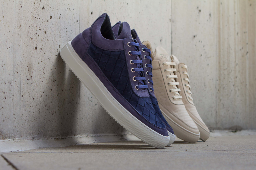 Filling Pieces Low Top in Marathon Beige and Low Top in Gradient Woven Navy Against Wall
