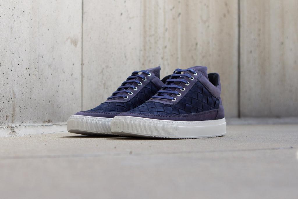 Filling Pieces Low Top in Gradient Woven Navy Against Wall