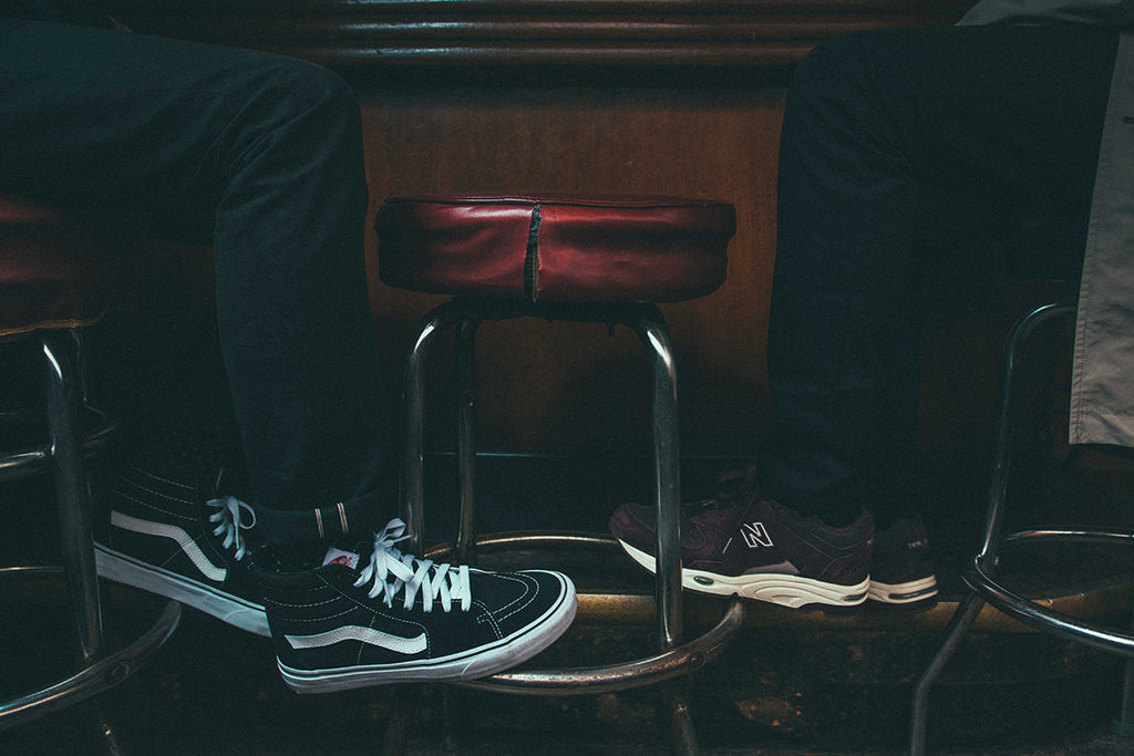 Vans and New Balance Shot at Bar