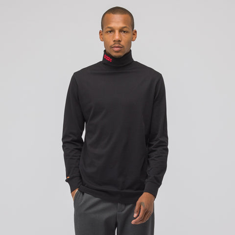 032C Embroidered Turtleneck in Black - Notre