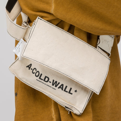 A-COLD-WALL* Canvas Utility Bag with Leather Strap in Natural - Notre