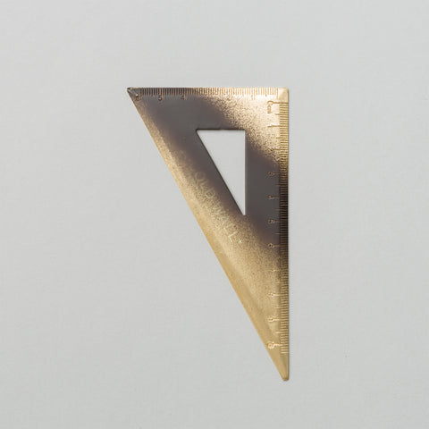 A-COLD-WALL* Engraved Gold Triangular Ruler - Notre