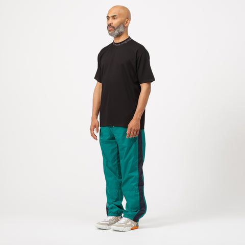 Acne Studios Phoenix Face Track Pant in Bright Green - Notre