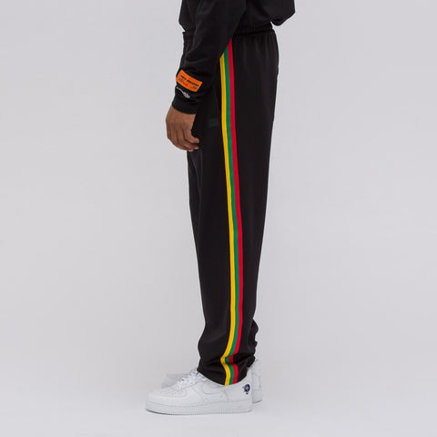 Acne Studios Norwich Face Track Pant in Black - Notre