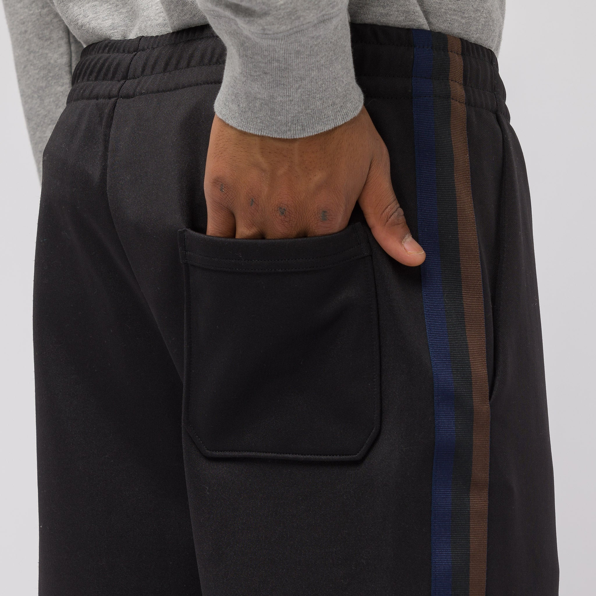 Norwich Face Track Pant in Black/Brown