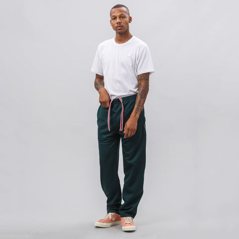 Acne Studios Norwich Face Track Pants in Bottle Green - Notre