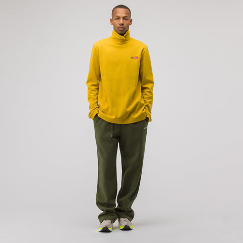 Adererror Over Wrapped Turtleneck T-Shirt in Mustard - Notre