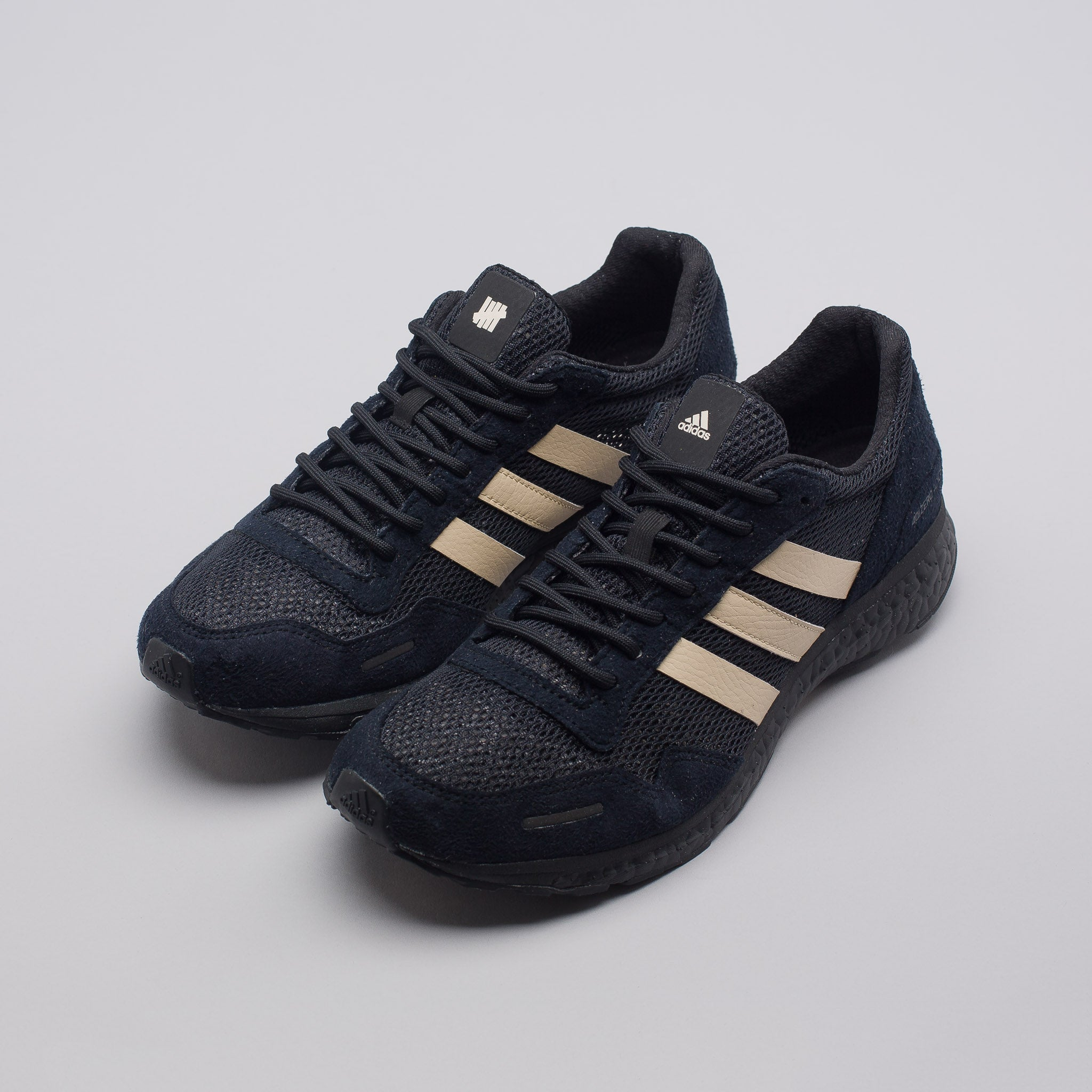 x UNDEFEATED Adizero Adios in Core Black/Dune