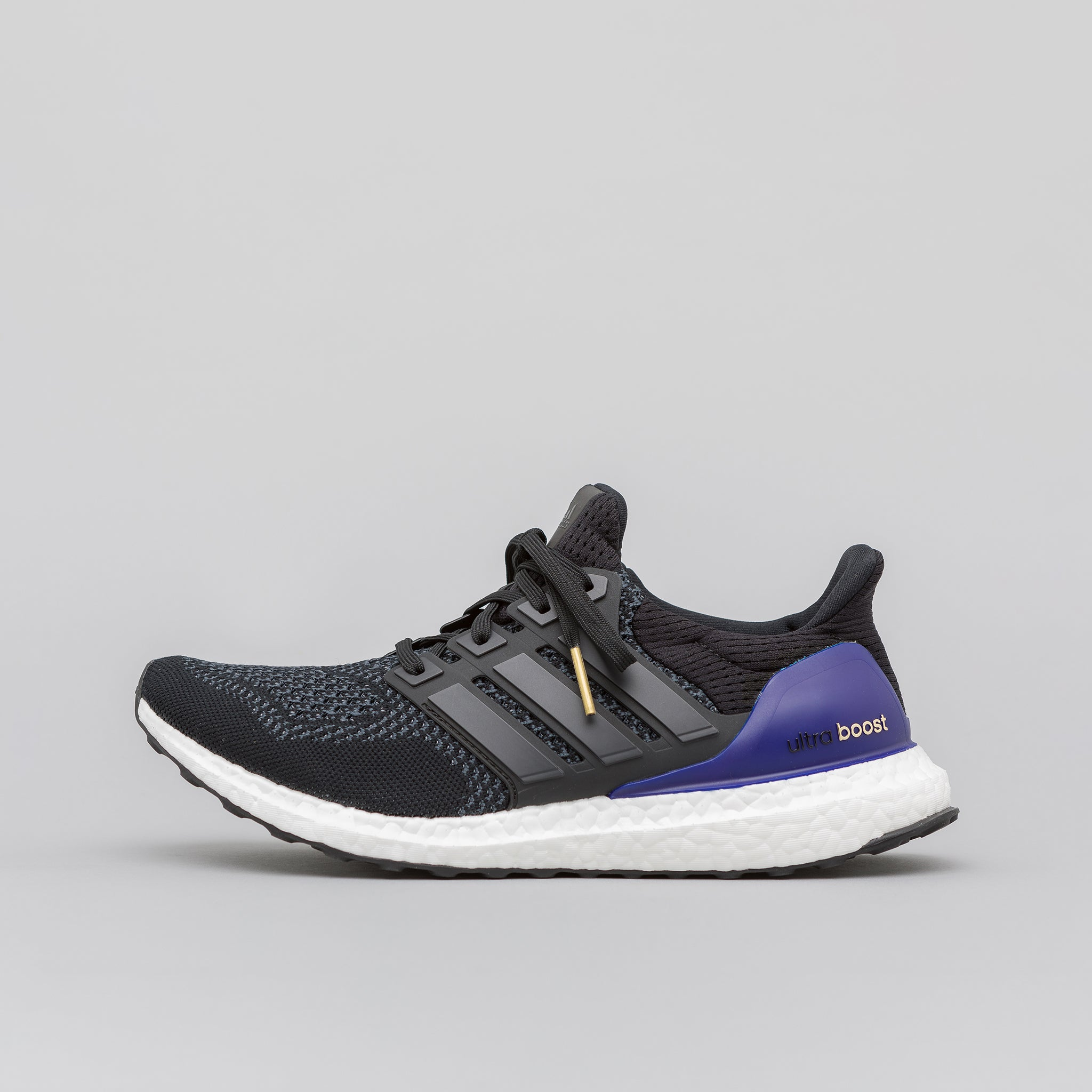 half off 747c2 925cf UltraBoost OG in Black Purple. adidas