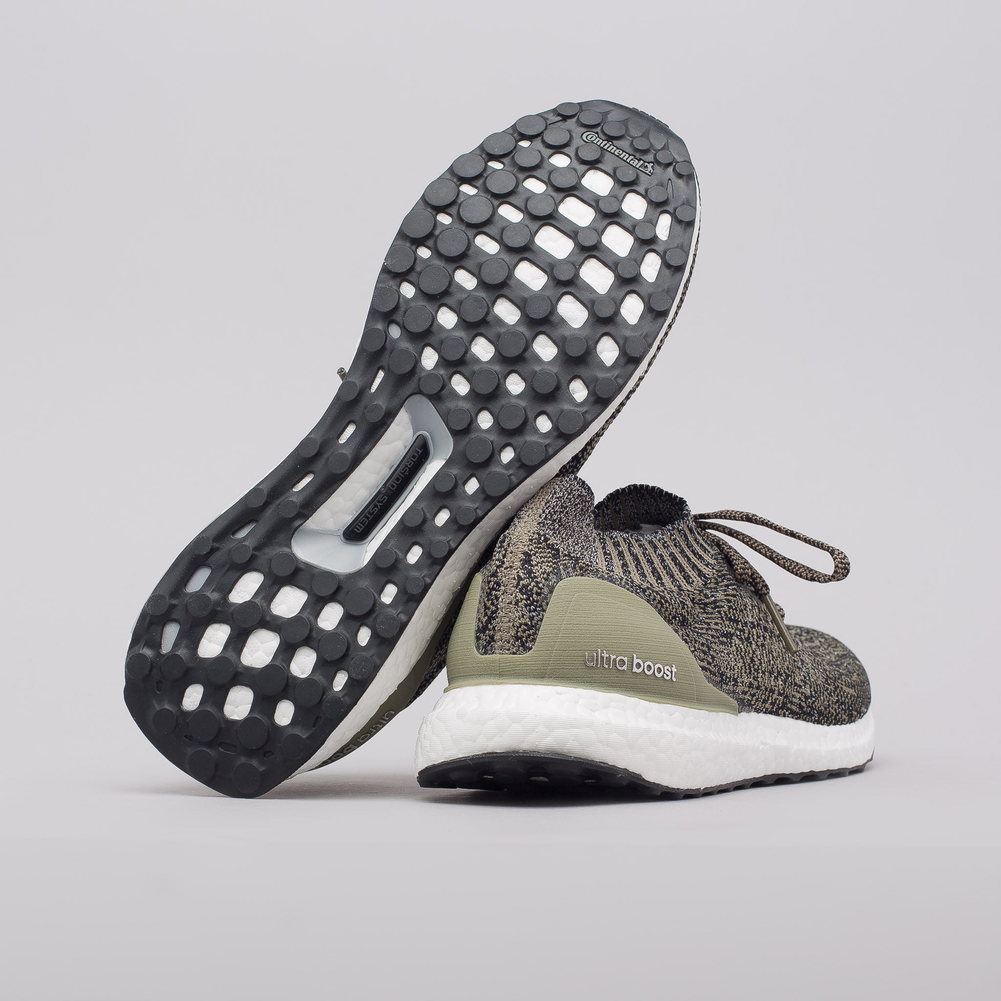 Ultra Boost Uncaged in Trace Cargo/Core Black