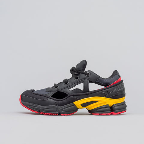 Adidas x Raf Simons Replicant Ozweego in Core Black/Gold - Notre