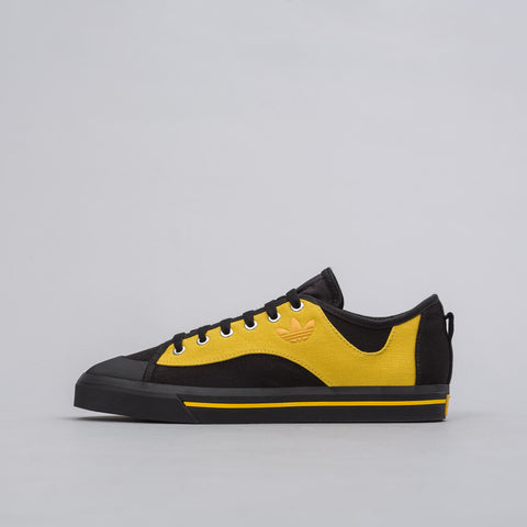 Adidas x Raf Simons Spirit V in Core Black/Corn Yellow - Notre