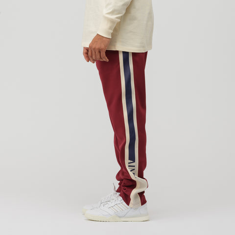 Aimé Leon Dore Aime Track Pants in Maroon - Notre