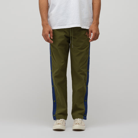 Aimé Leon Dore Nylon Track Pants in Chive/Boysenberry - Notre
