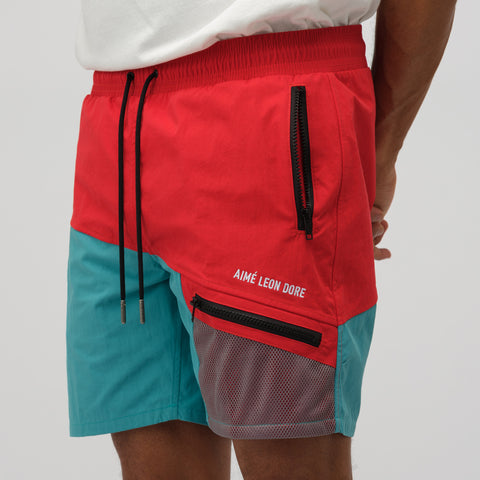 Aimé Leon Dore Zipper Pocket Shorts in Mineral Red/Tropical Green - Notre