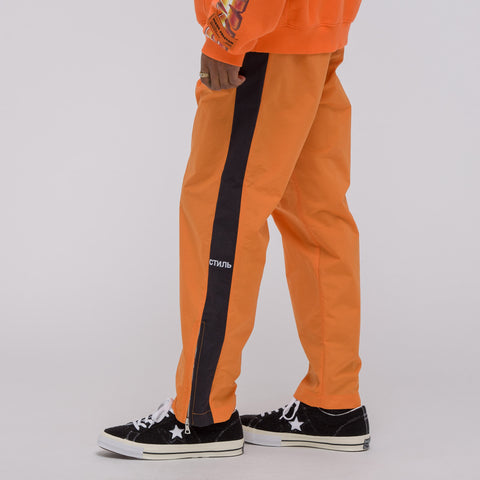 Heron Preston Style Loose Pants in Orange - Notre