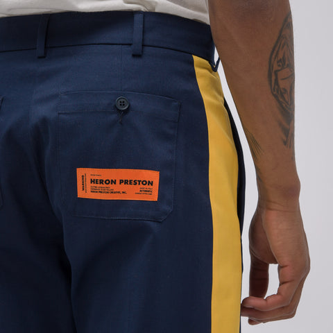 Heron Preston CTNMB Style Chino Pants in Dark Blue/Yellow - Notre