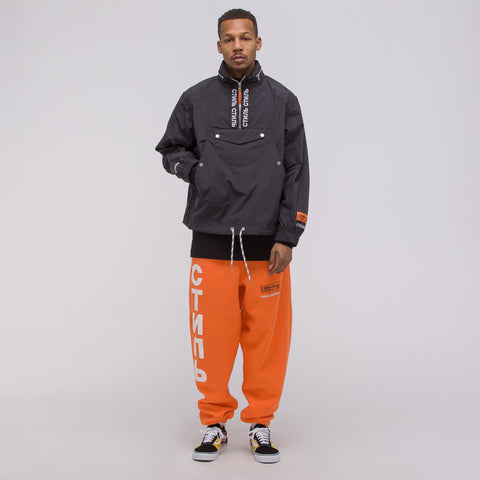 Heron Preston CTNMB Track Pants in Orange/White - Notre