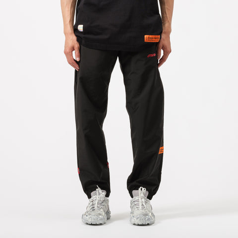 Heron Preston Elastic Nylon Pants in Black/Red - Notre