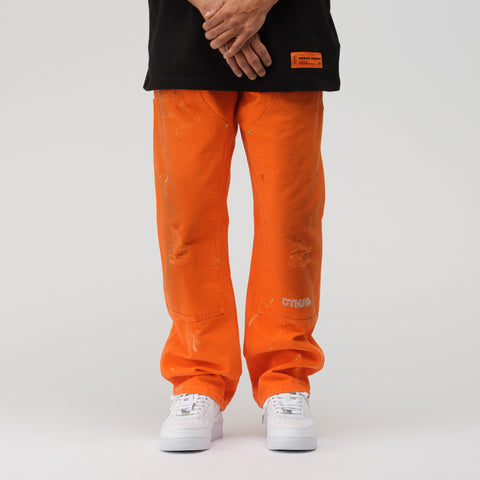 Heron Preston x Carhartt Pants in Orange Crystal - Notre