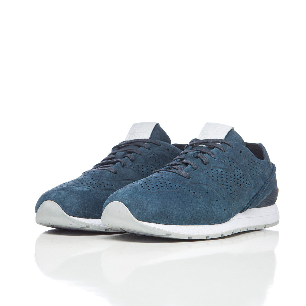 New Balance MRL696 Deconstructed Leather in Dark Navy Side Profile Studio shot MRL696DN