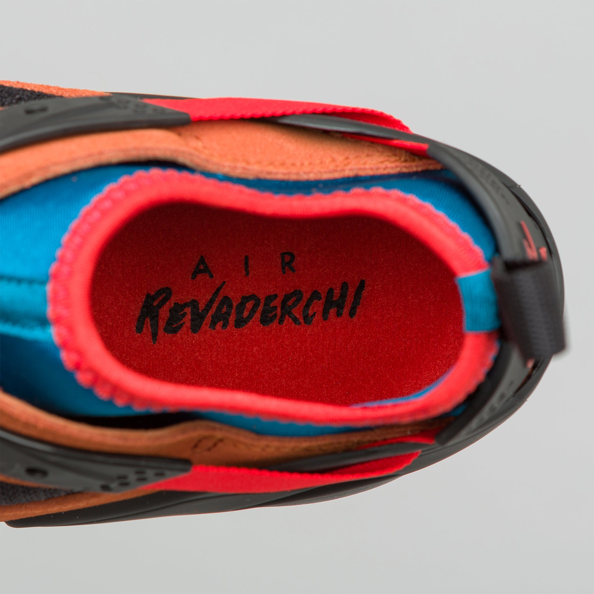 Air Revaderchi in Black/Habanero Red/Russet