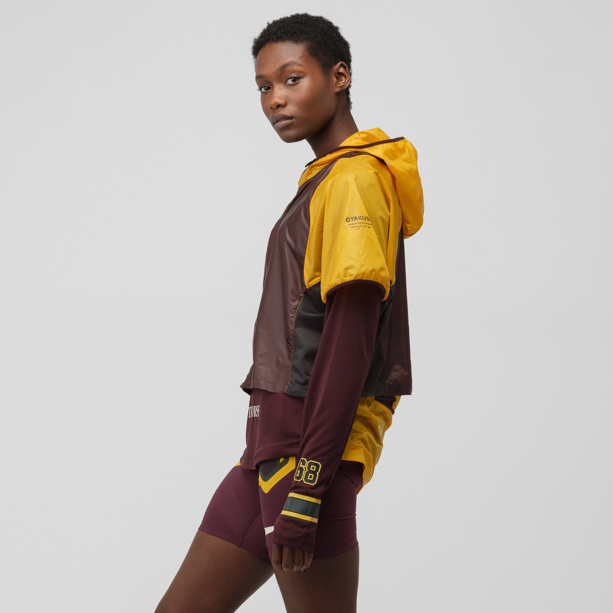 Women's Gyakusou Transform Jacket in Gold/Burgundy