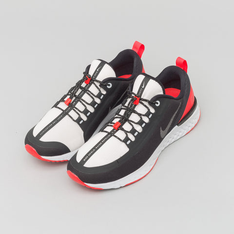 Nike Odyssey React Shield NRG in Black/Silver/Red - Notre