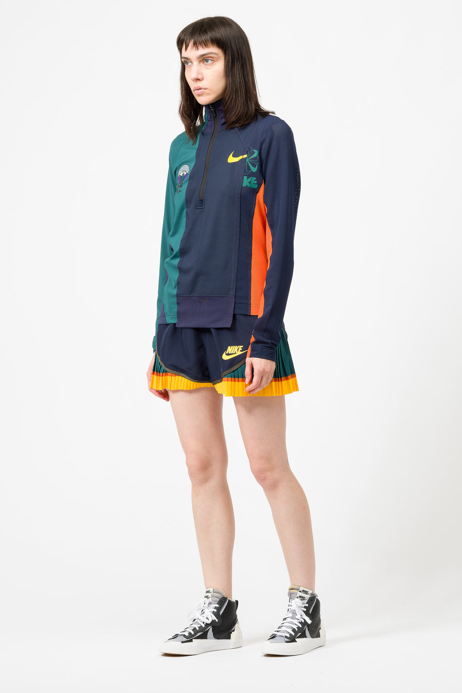 Nike Sacai Half-Zip Running Jacket in Obsidian/Rainforest - Notre