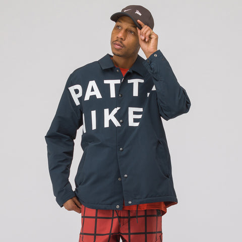 Nike x Patta Coaches' Jacket in Dark Obsidian/White - Notre