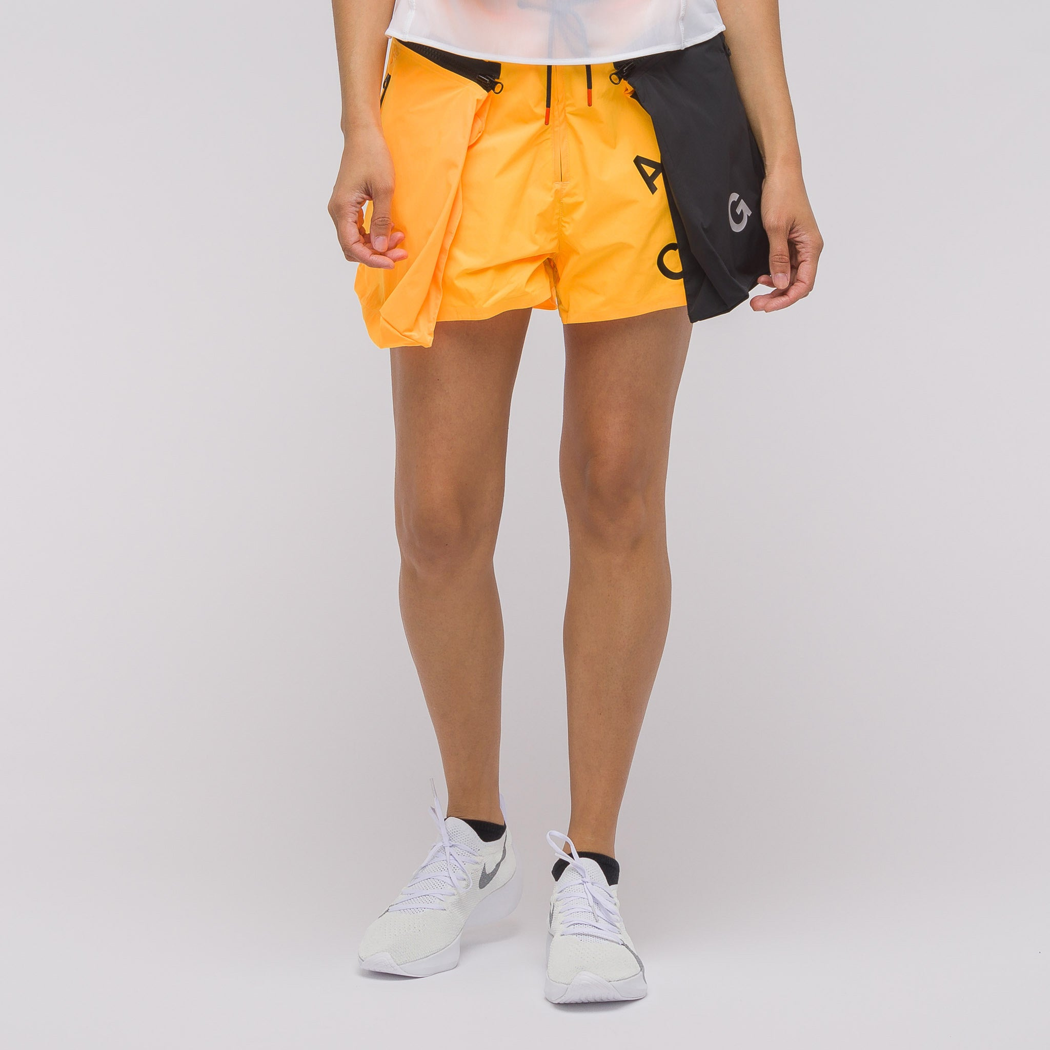 Women's ACG Short in Orange/Grey. NikeLab