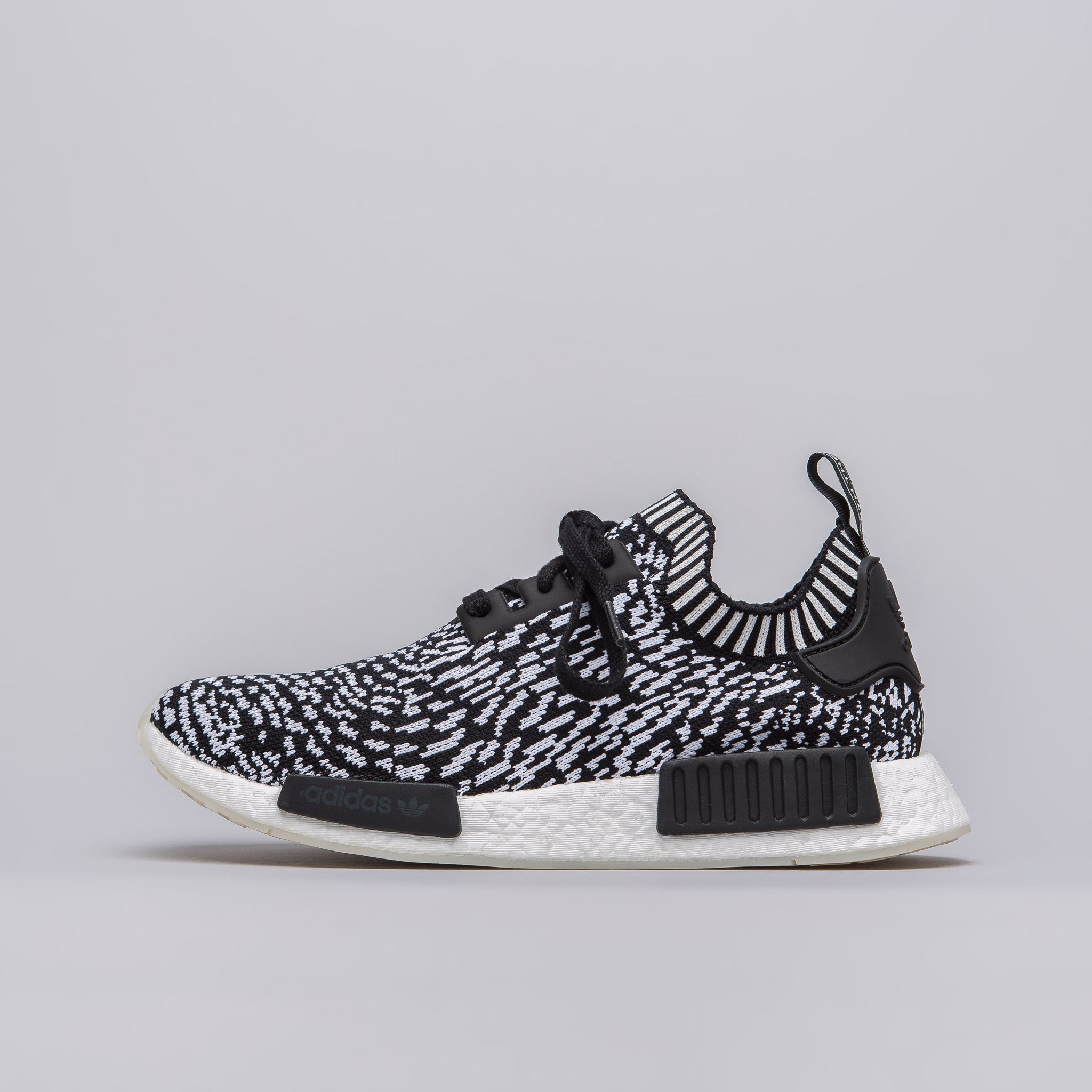 The adidas NMD R1 Primeknit Glitch Camo is back in a new White